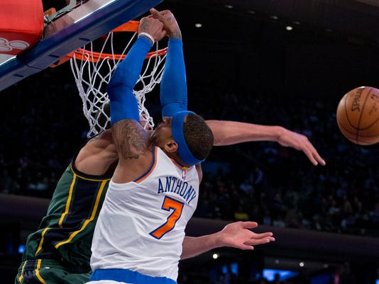 Utah Jazz center Rudy Gobert, left, blocks a dunk attempt by New York Knicks forward Carmelo Anthony (7) during the first quarter of an NBA basketball game, Wednesday, Jan. 20, 2016, in New York. (AP Photo/Julie Jacobson)