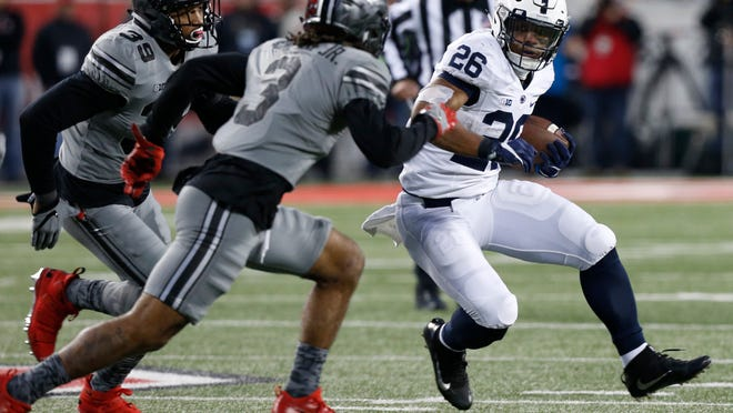 Penn State running back Saquon Barkley, right, cuts up field against Ohio State during the second half of an NCAA college football game, Saturday, Oct. 28, 2017, in Columbus, Ohio. Ohio State defeated Penn State 39-38. (AP Photo/Jay LaPrete)