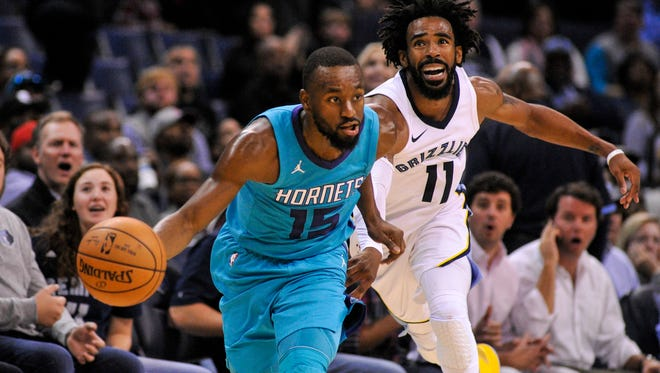 Oct 30, 2017; Memphis, TN, USA; Charlotte Hornets guard Kemba Walker (15) brings the ball up court against Memphis Grizzlies guard Mike Conley (11) during the second half at FedExForum. the Charlotte Hornets defeated the Memphis Grizzlies 104-99.