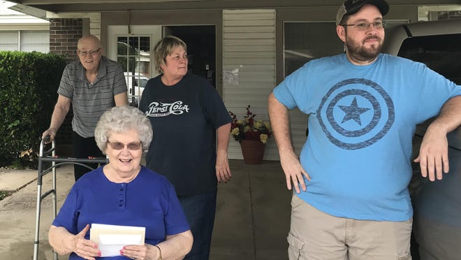 Virgil and Shirley Cowin are pictured outside thier home with their daughter, Becky Clark, and grandson, Brandon Clark, as members of the Cowins' Sunday school class surprise the couple to celebrate their 63rd anniversary.