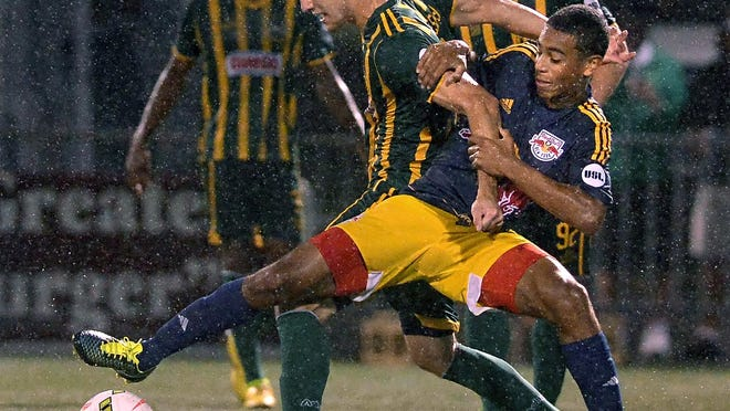 Rochester's Christian Volesky, left, fights for possession against New York's Tyler Adams during regular season game played at Sahlen's Stadium on Saturday, September 19, 2015. The Rochester Rhinos beat the NY Red Bulls II, 3-2.
