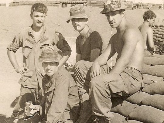 U.S. Army 1st Lt. Pat Sprinkel, second from left, with platoon members including best friend Ed Brady, left, in Vietnam.