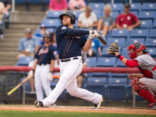 Binghamton Mets' Matt Oberste swings at a pitch during