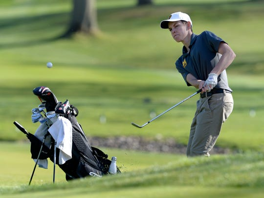 McQuaid's Max Dragon chips onto the seventh green during a regular season match against Victor at Oak Hill Country Club's East Course on Monday, April 30, 2018.
