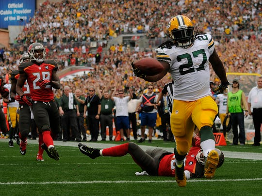 Green Bay Packers running back Eddie Lacy scores on a 44-yard touchdown run in the first quarter during Sunday's game at Raymond James Stadium in Tampa, Fla.