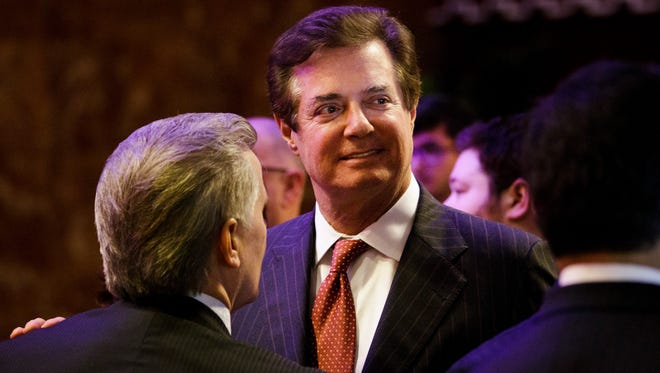 Paul Manafort. then campaign adviser for President Trump, talks with supporters and staff after a speech by Trump on the eve of his Indiana primary victory in New York on May 3, 2016