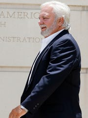 Cecil McCrory, a Brandon businessman, walks away from the federal courthouse in Jackson, Miss., Monday, July 18, 2016, after a hearing on evidence relating to himself.