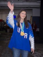 Farmington Hills native Megan Keller waves to the crowd