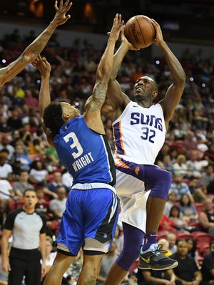 Davon Reed #32 of the Phoenix Suns shoots against Jay Wright #3 of the Orlando Magic during the 2018 NBA Summer League at the Thomas & Mack Center on July 9, 2018 in Las Vegas, Nevada. The Suns defeated the Magic 71-53.
