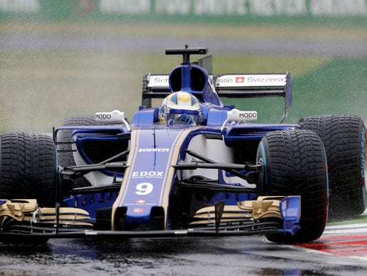 FILE - This is a Saturday, Sept. 2, 2017 file photo of Sauber driver Marcus Ericsson of Sweden as he steers his car during the qualifying session for Sunday's Italian Formula One Grand Prix, at the Monza racetrack, Italy. Force India and Sauber have dropped their complaint to the European Commission over anti-competitive practices in Formula One. (AP Photo/Antonio Calanni, File)