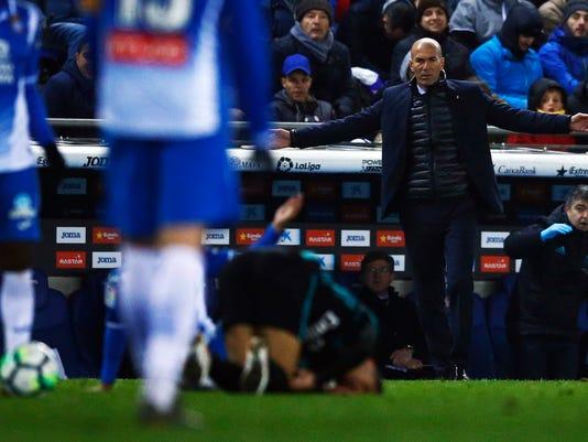 Real Madrid's coach Zidane reacts during the Spanish La Liga soccer match between Espanyol and Real Madrid at RCDE stadium in Cornella Llobregat, Spain, Tuesday, Feb. 27, 2018. (AP Photo/Manu Fernandez)