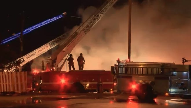 Dozens of firefighters worked on a 4-alarm fire in Walnut Hills on Monday night.