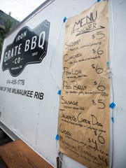 The menu for Iron Grate BBQ's food truck, parked on the patio behind Lost Whale from Thursday to Sunday, is written on butcher paper. Save for a sausage served on a bun, everything is grilled on skewers.