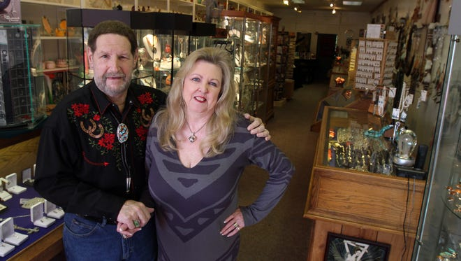 Norman and Jamey Seldin stand in their Red Bank store, Seldin's Trinkets and Jewelry.