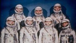 NASA's original seven Mercury astronauts pose in their