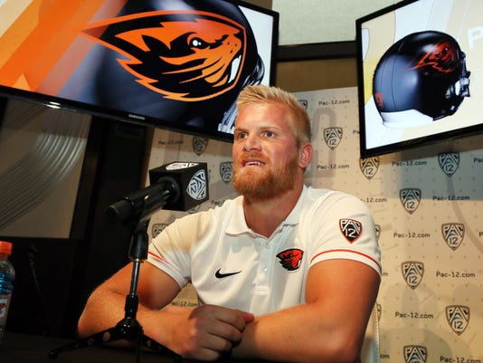 Oregon State punter Nick Porebski speaks at the Pac-12 NCAA college football media day in Los Angeles Friday, July 15, 2016. (AP Photo/Reed Saxon)