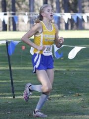 Molly MacQueen of Trumansburg runs to a ninth-place finish in the girls Class D race Saturday at the New York State Public High School Athletic Association cross country championships at Chenango Valley State Park.