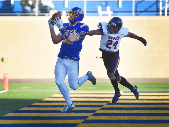 South Dakota State's Dallas Goedert makes a catch in the end zone against University of Northern Iowa's Nikholi Jaghai during their game on Dec. 2, 2017.