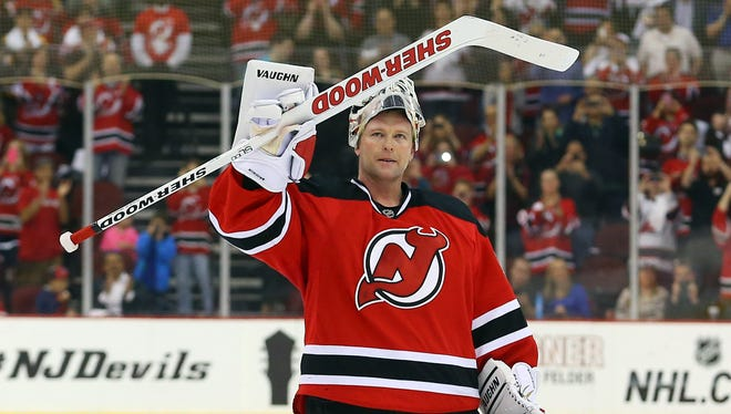 New Jersey Devils goalie Martin Brodeur is honored by fans after his 3-2 win against the Boston Bruins at Prudential Center.