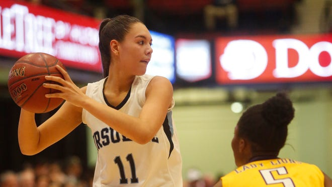 Ursuline's Korina Guerra looks to make a pass during the Koalas' game against Bishop Loughlin during the semifinals at the 18th Annual Slam Dunk Tournament at the Westchester County Center in White Plains on Wednesday.  Ursuline won 53-43.