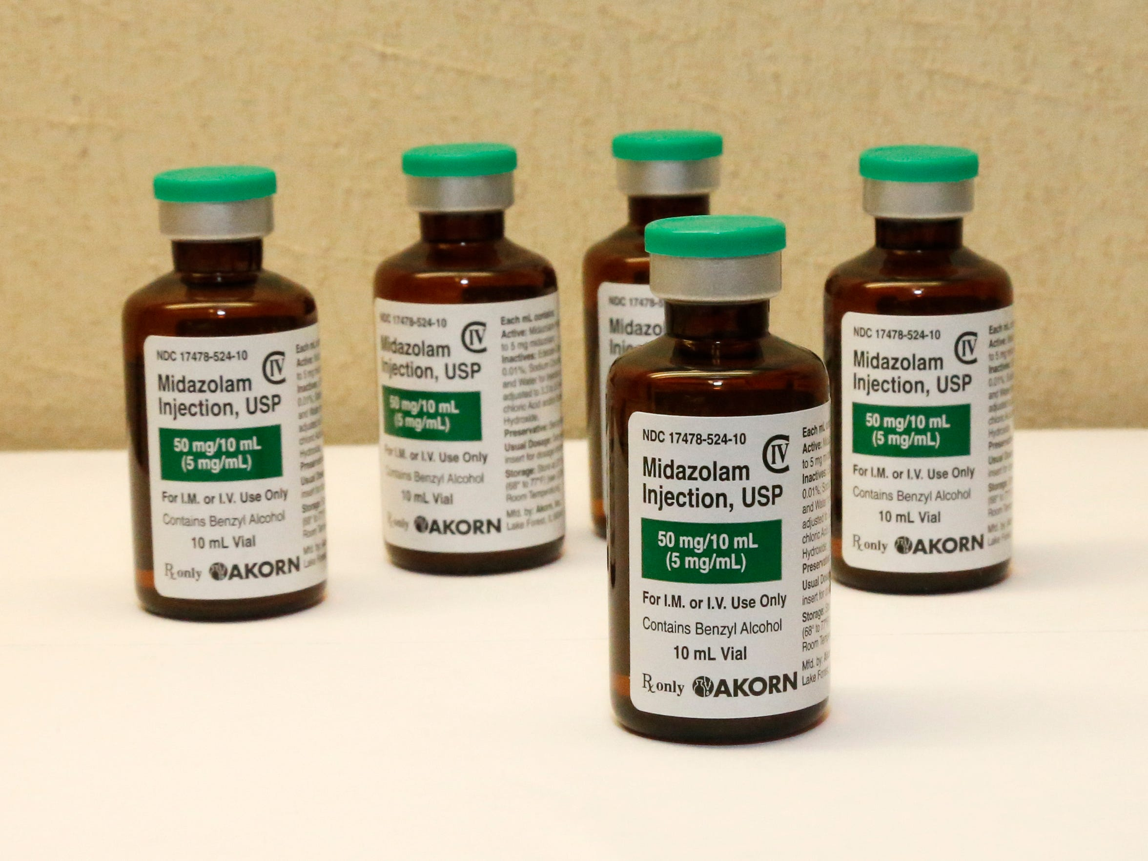 Bottles of the sedative midazolam are displayed at a hospital pharmacy in Oklahoma City.