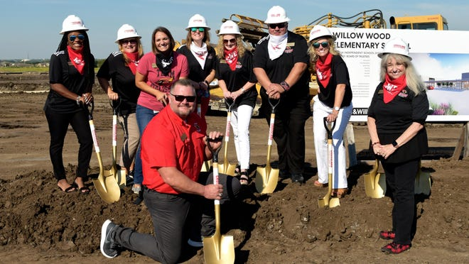 Melissa ISD Superintendent Keith Murphy, center, and the elementary school leadership team pose for a photo at the Aug. 20 groundbreaking ceremony for Willow Wood Elementary School.
