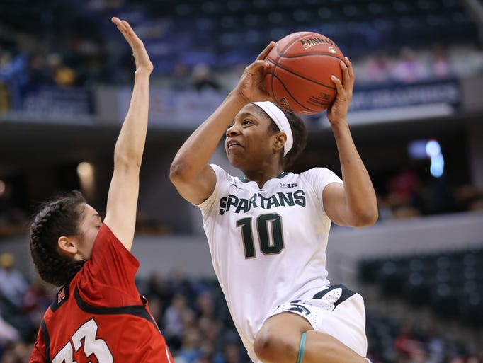Michigan State's Branndais Agee drives through Nebraska's Rachel Theriot in the 2014 Big Ten Women's Basketball Tournament held at Bankers Life Fieldhouse in Indianapolis on Saturday, March 8, 2014. Nebraska beat Michigan State 86-58.