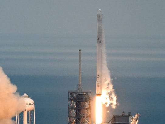 A SpaceX Falcon 9 rocket blasts off from Kennedy Space