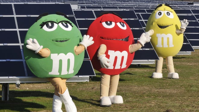 Green, Red and Yellow M&M?s frolic at the opening of a solar garden at Mars headquarters in Hackettstown. Green, Red and Yellow M&M's frolick at the opening of a solar garden at Mars headquarters in Hackettstown.