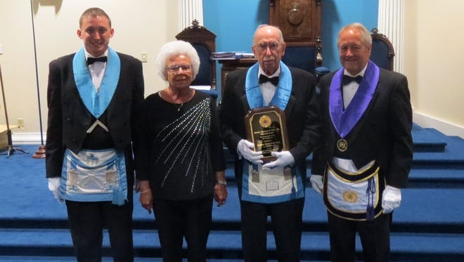 Pictured from left to right: Brother Abram M. Shaffner, W.M., Mary Jane Wolfe, Brother Richard R. Long and Brother Larry A. Derr, DDGM.