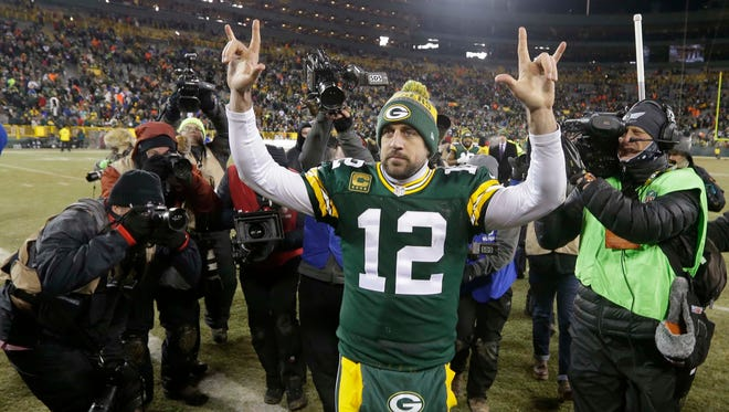 Packers quarterback Aaron Rodgers leaves Lambeau Field to cheering fans after Green Bay's 38-13 win over the  New York Giants in an NFC wild-card game Jan. 8, 2017.