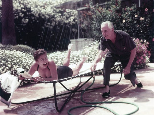 William Powell and Mousie at their home in Palm Springs c. 1952.