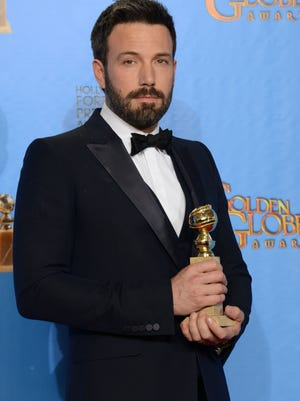 "Actor and director Ben Affleck poses with the award for best motion picture - drama for ""Argo"" backstage at the 70th Annual Golden Globe Awards at the Beverly Hilton Hotel on Sunday Jan. 13, 2013, in Beverly Hills, Calif."
