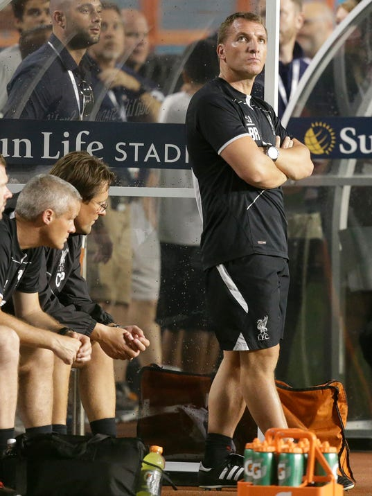 Liverpool's manager Brendan Rodgers, right, looks up at the scoreboard in the second half during the final of the Guinness International Champions Cup soccer match between Liverpool and Manchester United, Monday, Aug. 4,  2014, in Miami Gardens, Fla. Manchester United defeated Liverpool 3-1. (AP Photo/Lynne Sladky)