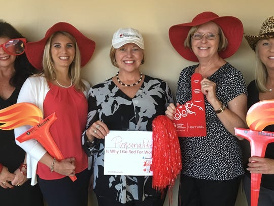 Go Red  Plans are underway for the Go Red for Women luncheon, Feb. 17 at the Old National Events Plaza.  Members of the committee arrived for a meeting sporting photo booth garb as they reviewed information dealing with the newly employed mobile bidding.  From left are Malissa Troutman, Lindsay Botsch, Penny Goshert, Marcia Minton and Angie Schaffstein. It is never too early to make your plans so for more information contact Malissa at Malissa.Troutman@heart.org o r270-929-9585.