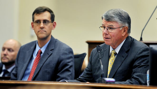 Metro Nashville Public Schools Director Jesse Register, right, speaks as Alan Coverstone looks on during a Metro Council meeting July 10, 2014.
