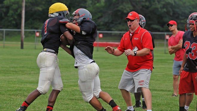 Head coach Dan Russo prepares his team during practice at the Vineland High School on Tuesday. July 14, 2015. Staff photo/Craig Matthews