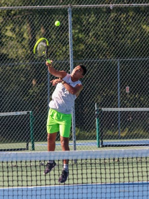 Hillsdale No. 1 doubles' player Jon Torres serves during a pre-season practice. HDN File Photo: Sam Fry