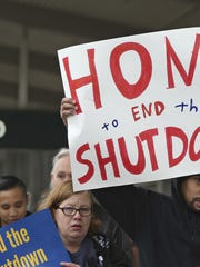 More than two dozen federal employees and supporters demonstrate at the Sacramento International Airport calling for President Donald Trump and Washington lawmakers to end then partial government shutdown, Jan. 16, 2019, in Sacramento, Calif.
