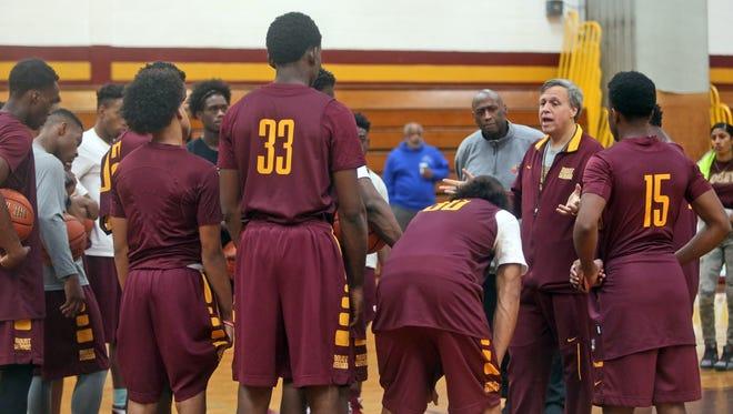 Mount Vernon High School basketball coach Bob Cimino talks to his players during practice Nov. 25, 2015.