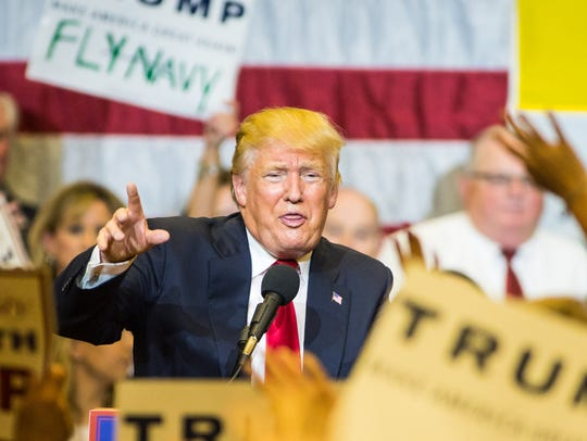 Donald Trump speaks to a packed gym during a rally