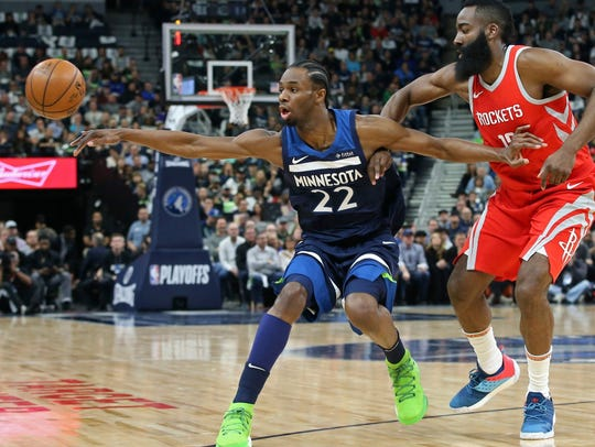 Minnesota Timberwolves' Andrew Wiggins, left, loses