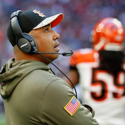 Bengals head coach Marvin Lewis checks out a replay