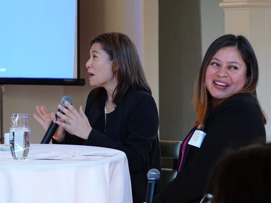 California Chief Justice Tani Cantil-Sakauye, left, got some laughs in Ventura on Saturday morning while speaking with Jeannette Sanchez-Palacios, right, president of the Ventura County Women's Political Council.