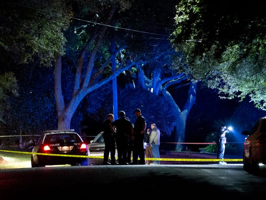 Authorities investigate the scene Saturday, Nov. 7,