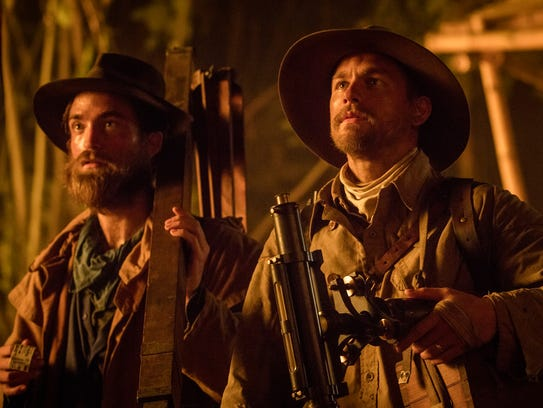 Robert Pattinson, left, as Henry Costin and Charlie