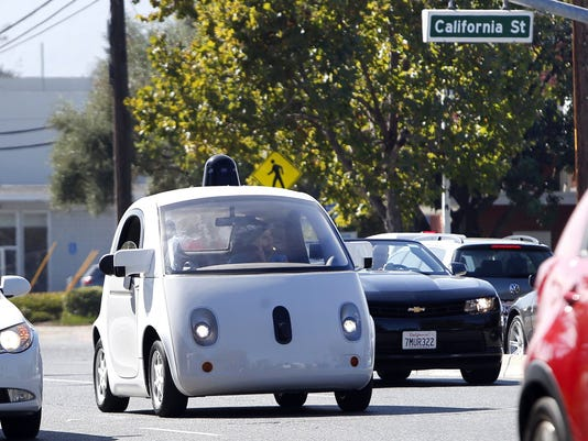 Google, Tesla, others wait for DMVÌs self-driving rules