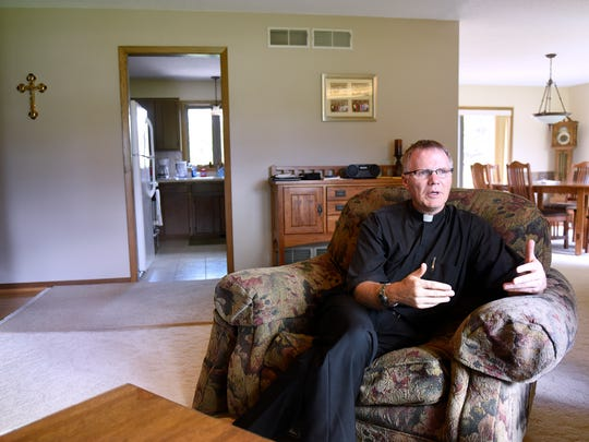 The Rev. David Grundman talks about his recovery process after becoming a kidney donor during an interview Wednesday, July 13, 2016, in St. Cloud. Grundman is a priest at St. Michael's Church in St. Cloud.