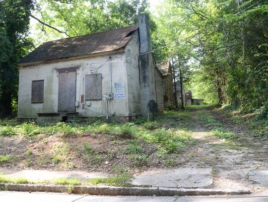 Empty homes at 312-316 Morris Street in Anderson, were