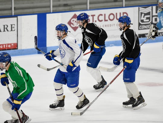 Cathedral players skate during practice Friday, Dec.